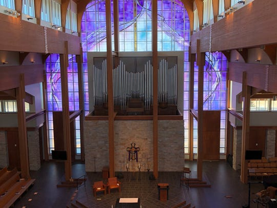The stained-glass window at Holy Family Catholic Church is 65 feet tall by 60 feet wide.