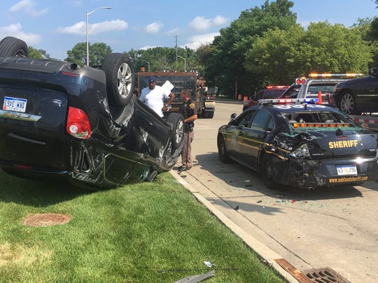 The vehicle of an Oakland County Sheriff's Office detective was overturned after a crash on Woodward Avenue in Pontiac the morning of Friday, Aug. 3, 2018.
