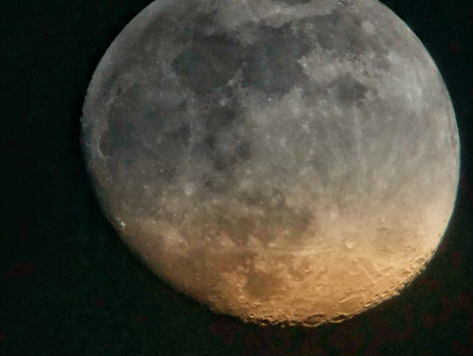 The moon last night was covered in clouds as they blew