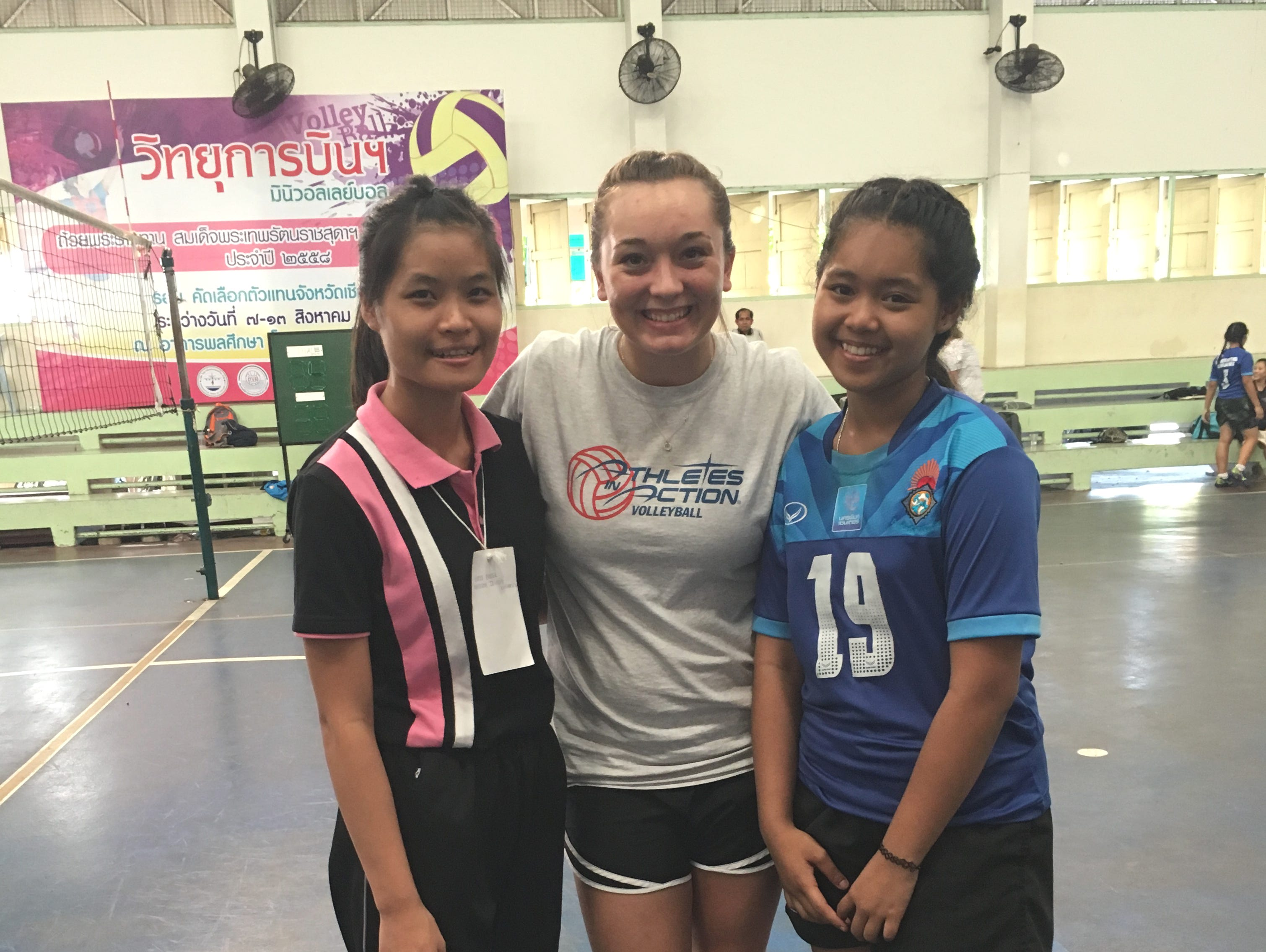 Willard's Makenzie Bouse (center) poses for a photo with two volleyball players from Thailand whom Bouse mentored during a trip to Thailand with Athletes in Action.