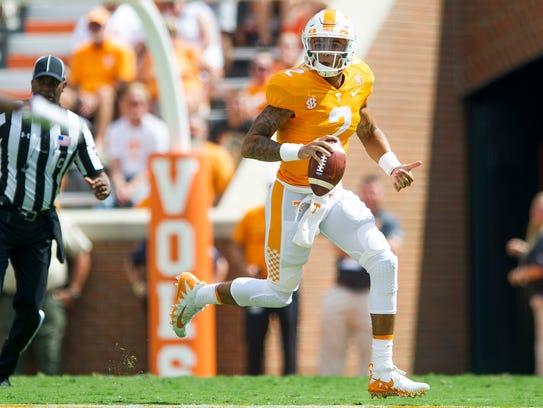 Tennessee quarterback Jarrett Guarantano (2) runs down