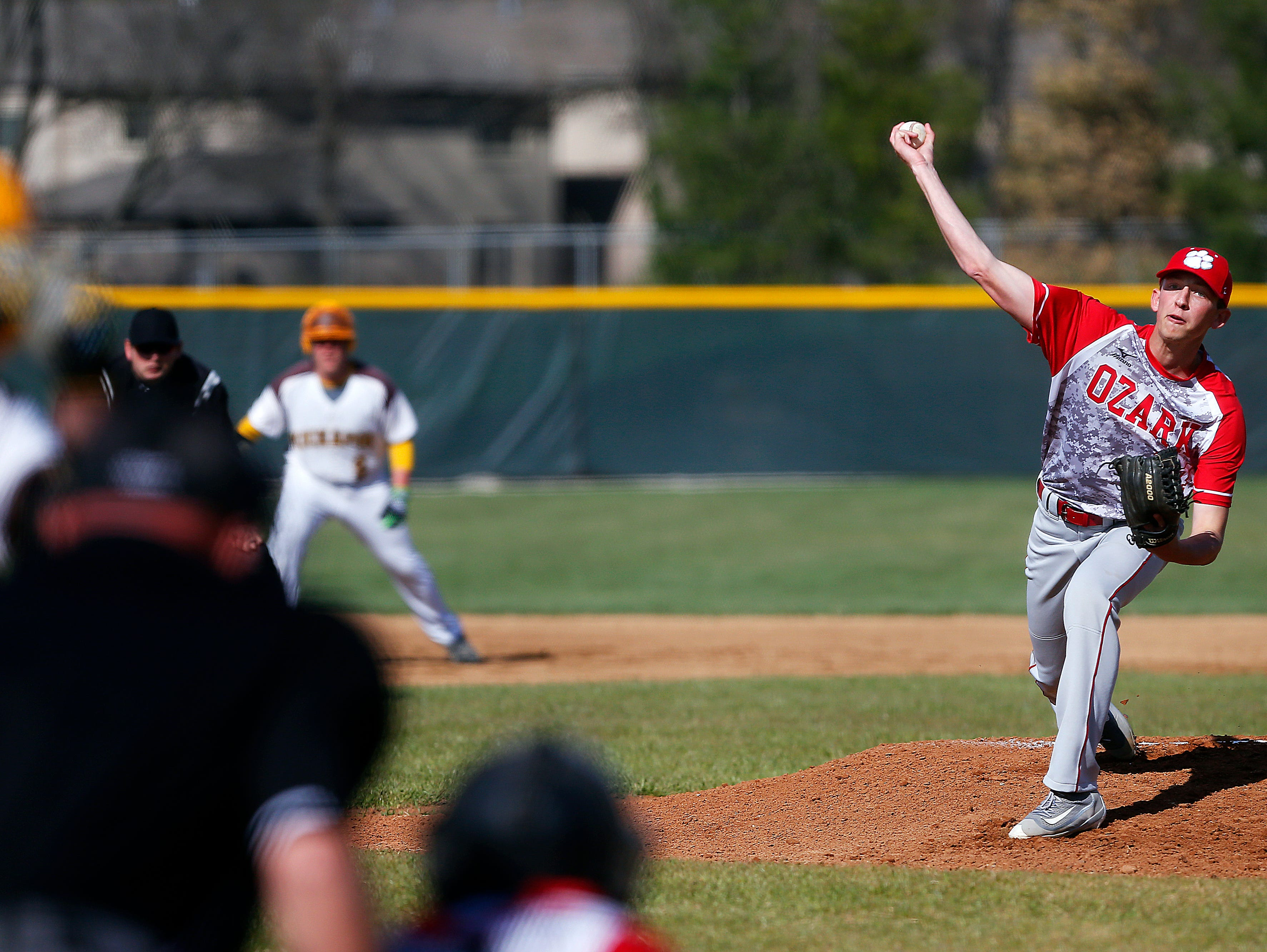 Ozark High School pitcher Tanner Wallace (34) pitches during first inning action of the high school baseball game between Kickapoo and Ozark at Kickapoo High School in Springfield, Mo. on March 29, 2016.