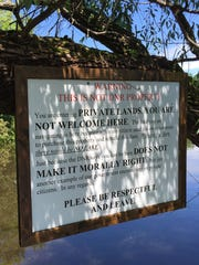 A sign over the upper Scuppernog River where it enters Upper Spring Lake tells visitors that they are on private property.