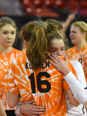 Burlington's Maddie Berezowitz hugs Abby Koenen after losing to Neenah in the championship match.