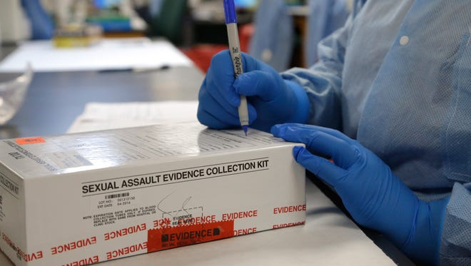 A sexual assault evidence collection kit is checked in by a forensic analyst for testing.
