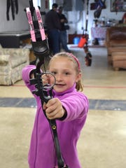 Mackenzie Shull, 7, of Mount Crawford shows her shooting stance on the first day of the Rinehart Targets R100 Traveling Archery Tournament on Saturday, May 6, 2017, at the Augusta Archers Club in Staunton. Over 450 shooters are expected to attend the two-day event.