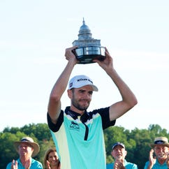 Troy Merritt hold up the Quicken Loans National trophy