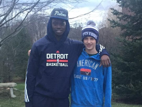 Pistons guard Reggie Jackson and Sam Kell