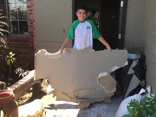 Current and former L. Leo Judice Elementary students are helping school librarian Lisa Labarraque restore her flooded home.