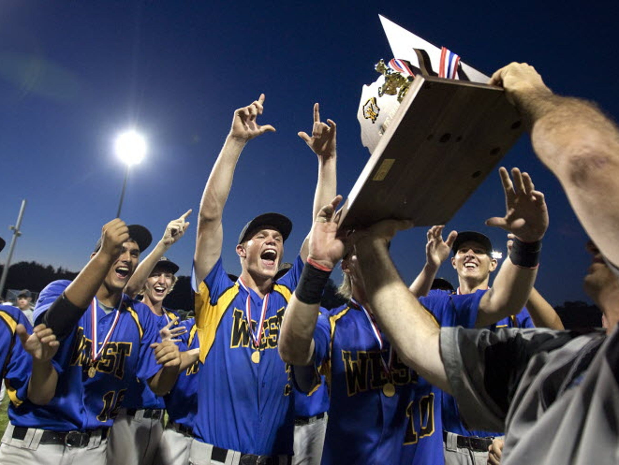 New Berlin West players hoist the first baseball state