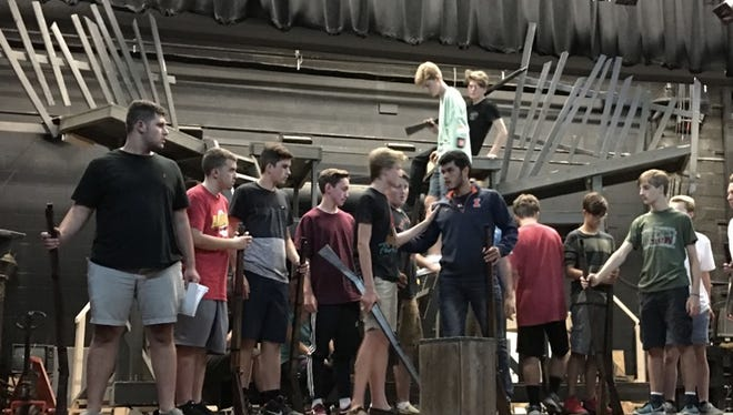 A scene at the barricade in The Belmont Theatre's upcoming performance of 'Les Miserables.'