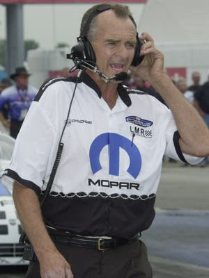 Indianapolis Raceway Park Aug 30 2003.  US Nationals. Staff Photo Greg Griffo file 88002. Crew Chief for the Larry Morgan Pro Stock racing team Bob Glidden former Pro Stock champion talks with the driver as he finishes his first  pass at ethe US Nationals. W/ Ballard story