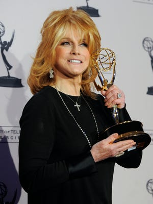 Ann-Margret poses in the press room with the award for outstanding guest actress in a drama series for 'Law & Order: Special Victims Unit' at the Creative Arts Emmy Awards on Aug. 21, 2010 in Los Angeles.