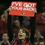 Louisville fans held up 'I've Got Your Back' signs before the Boston College game Saturday afternoon at the KFC Yum! Center.  Feb. 6, 2016