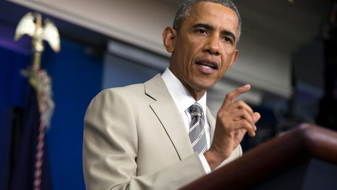 In this Aug. 28, 2014 file photo, President Barack Obama speaks in the James Brady Press Briefing Room of the White House in Washington, before convening a meeting with his national security team on the militant threat in Syria and Iraq. The U.S. and its allies are trying to hammer out a coalition to push back the Islamic State group in Iraq. But any serious attempt to destroy the militants or even seriously degrade their capabilities means targeting their infrastructure in Syria. That, however, is far more complicated. If it launches airstrikes against the group in Syria, the U.S. runs the risk of unintentionally strengthening the hand of President Bashar Assad, whose removal the West has actively sought the past three years. Uprooting the Islamic State, which has seized swaths of territory in both Syria and Iraq, would potentially open the way for the Syrian army to fill the vacuum.
