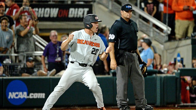 Oregon State Beavers infielder Zach Clayton (20) celebrates after scoring a run during the ninth inning against the Arkansas Razorbacks in Game 2.