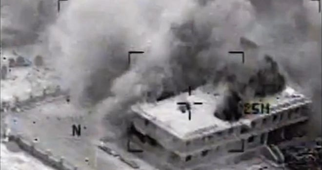A structure in Syria is hit in a U.S. airstrike.