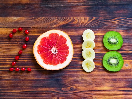 happy new year 2018 of fruit and berries on wooden background.