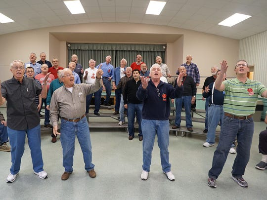 The Fun Center Chordsmen rehearse at the First Congregational