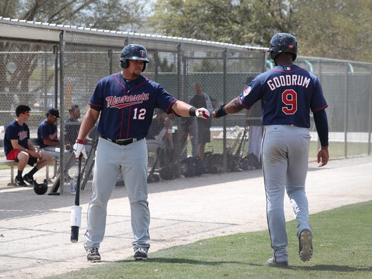 Niko Goodrum infielder for the Minnesota Twins' organization, fist bumps a teammate after he scored in their game against Tampa Bay Rays in their minor league game Thursday, March 23, 2017. Minor league camp can beat big-league camp from a fan's perspective. You can get up close to future big league players and all the action. Many spectators become friends and get an inside scoop to the future team.