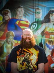 James Gray, one of the owners, and Katie Manchester, comic manager, help make sure Mayhem Collectibles is full of treasures for the comic book crowd both young and old.