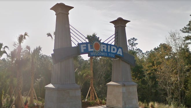 Newly installed in 2015, this bridge-shaped structure featuring bold font and a bright orange sun introduces drivers into Florida's state lines.