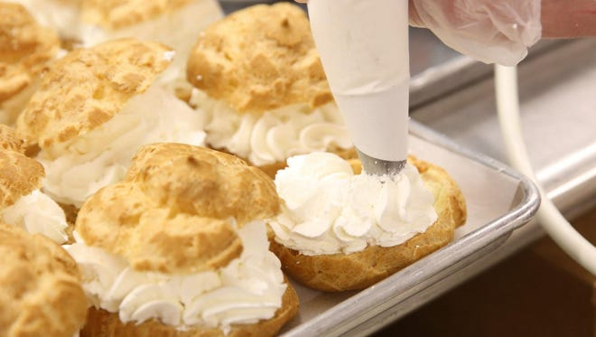 Joey Kovnesky fills a cream puff at the 2015 Wisconsin State Fair.