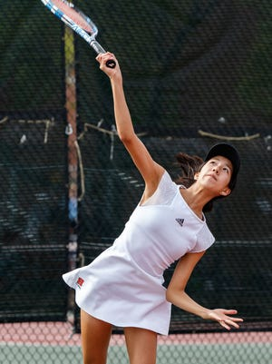 Senior Natalie Yang plays singles for Homestead, the state's top-ranked Division 1 team.