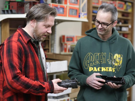 Customer Craig Thoms, left, and shop owner Chris Freimuth talk about classic trains at Replay Toys in Appleton.