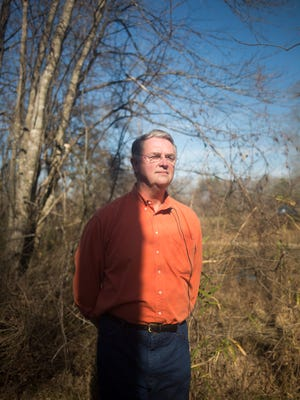 Southern Environmental Law Center senior attorney Frank Holleman stands on the bank of Brown's Creek in a recent inspection of the site of the Plantation Pipe Line gasoline spill near Belton.