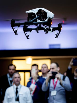 Visitors look at a drone during the opening of the Unmanned Systems Expo (TUSExpo) in The Hague, The Netherlands, on Feb. 4.
