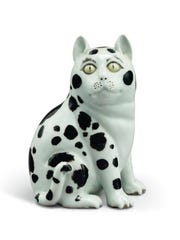 Chinese figure of a seated cat will be sold in an online auction of David and Peggy Rockfeller's personal possessions.