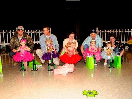 The 1-year-old winners are, from left, Finley Roper, third runner-up, LilyAnn Smith, first runner-up, Chanley Green, Tiny Princess; Gabriella Kuns, second runner-up; Adeline Monck, fourth runner-up. Other winners not pictured are Addalie Carpenter, Happiest; McKena Mathes, People's Choice and Prettiest Dress; Brynleigh Hodges, Most Natural; Kourttlyn Johnson, Prettiest Eyes; Miley Howell, Prettiest Smile; Kenadee Lill, Best Personality; and Briley Pulley, Sweet Cheeks