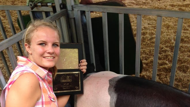 Paige Cords is shown with one of her 4H awards. The teen was killed in a car crash Tuesday in Bellevue Township.