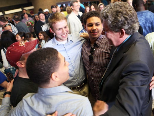 """Former Winton Woods students Blake Howard and Jalen Walker, center facing camera, give a group hug to David Bell, right, music director at Winton Woods High School before a recent musical at the Forest Park school. After educating about 9,000 students, Bell is retiring after 32 years with Winton Woods and three years with Dayton Public. """"In 35 years I have asked a lot of my students they have never disappointed me"""", Bell said. During Bell's tenure Winton Woods High choirs has performed over 35 times with the Cincinnati Symphony Orchestra and Cincinnati Pops and performed in China in 2008 for a """"Salute to the 2008 Beijing Olympics""""."""