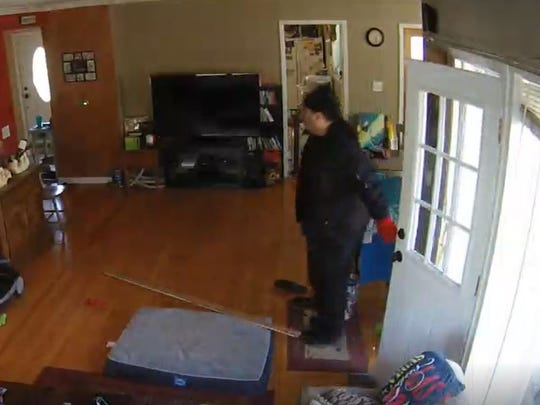 A burglary suspect is caught on security video immediately after kicking in the back door of a Flanders home to gain entry at 9:30 a.m. Feb. 13. Police say the suspect made off with items including jewelry and handgun ammunition. Trim from the door frame can be seen on the floor.