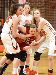 Viola's Destiny Crawford, left, Amanda Martin and Emily Perryman, right, try to pry the ball away from a Hillcrest player during the Lady Longhorns' 50-31 loss Tuesday night in the 1A-2 North District Tournament at Longhorn Corral.