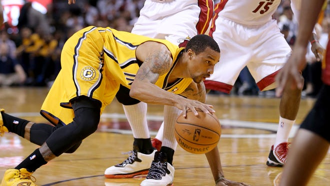 Indiana Pacers guard George Hill tries to control his dribble when against the Miami Heat in Game 3 of the NBA Eastern Conference Finals May 24 at American Airlines Arena.
