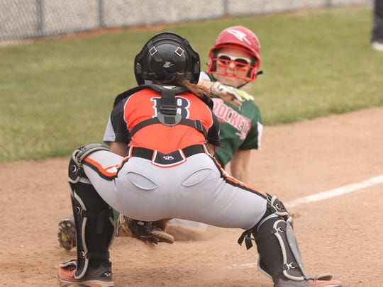 Oak Harbor's Seree Petersen is tagged out by Gibsonburg's Jessica Davies.