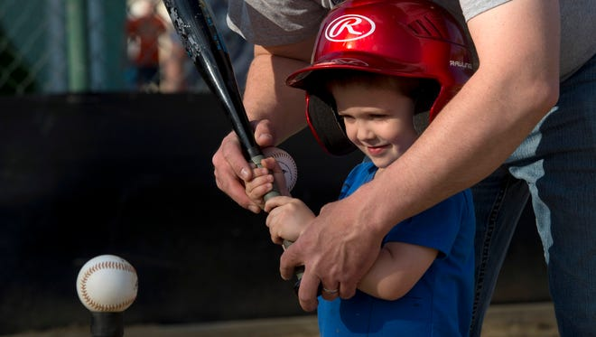 """""""The next one you hit, drop your bat and run to first base,"""" Chris Leslie of Chandler, Ind., told his 3-year-old son, Reid. This is the first year of tee-ball for the youngster and it was evident he was succeeding in the most important aspect of the game... having fun."""