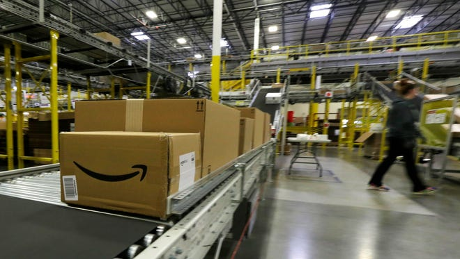 An Amazon box moves along a conveyor belt Monday, Nov. 30, 2015, at Amazon.com's fulfillment center in DuPont, Wash.