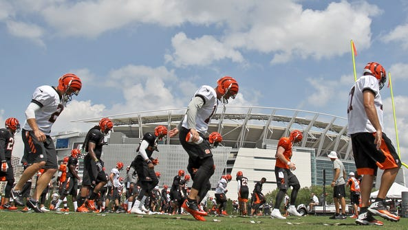 The Cincinnati Bengals work out at training camp last