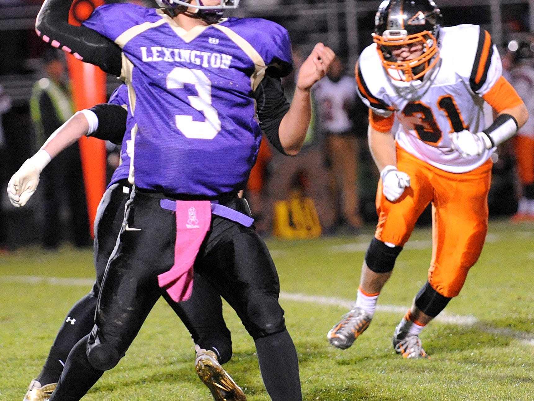 Lexington's Joseph Vore passes the ball Friday night during their game against Ashland.