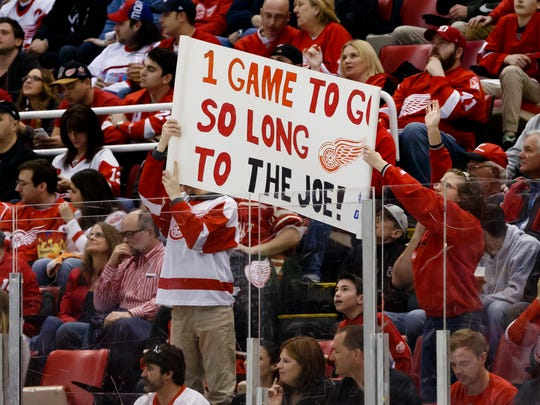 Fans hold up a sign during the third period of the
