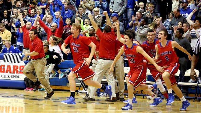 Conner players erupt off the bench as time runs out in their win over Cooper Friday.
