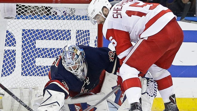 New York Rangers goalie Antti Raanta (32) stops a shot on the goal by Detroit Red Wings' Riley Sheahan (15) during the second period.