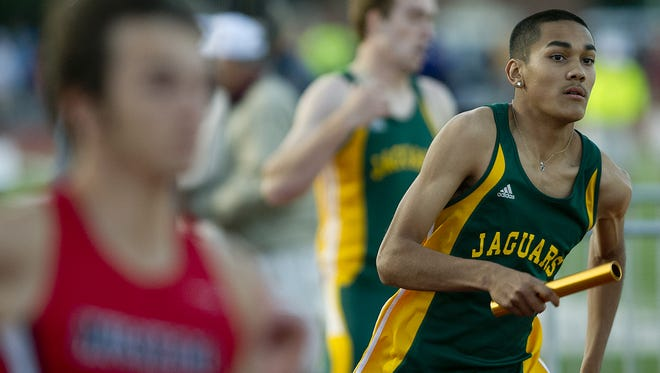 Ashwaubenon's Jose Guzman competes in the 1600-meter relay at the WIAA state track and field meet in La Crosse last year. Guzman leads local competitors in the 200 and 400 this season in addition to being a leg on the Jaguars' 1,600 relay team.