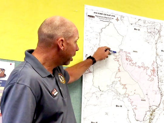 Operations section chief Alex Robertson of the Portland National Incident Management Organization shows the area where the 416 Fire made a run through some wild land Tuesday afternoon before slowing again as he conducts an online operational briefing Wednesday morning.