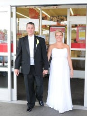 Having met at as co-workers at the Garden City Kmart, Joe and Kristin Bandy stopped by the store following their wedding reception in 2010.
