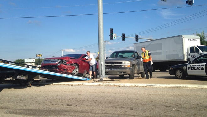 A red sedan is loaded on a trailer following a two-vehicle accident at the intersection of U.S. Highway 62 and AR Highway 126 in Gassville late Monday afternoon. One of the drivers involved was transported to Baxter Regional Medical Center.